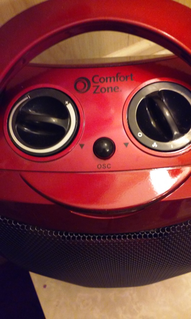 face on heater. knobs as eyes button nose